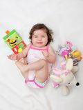 Beautiful baby girl with her favorite toy Stock Photos