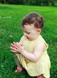Beautiful baby girl holding flower Stock Photo