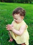 Beautiful baby girl holding flower Stock Photo
