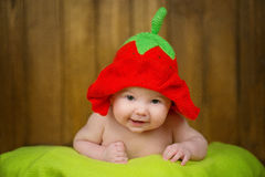 Beautiful baby girl in a knitted hat strawberry Royalty Free Stock Photography