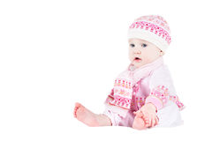 Beautiful baby girl in a knitted sweater, hat and scarf Stock Images