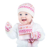 Beautiful baby girl in a knitted sweater, hat and scarf Royalty Free Stock Photography