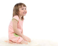 Beautiful baby girl looks somewhere Royalty Free Stock Images