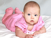 Beautiful baby girl lying Stock Photos