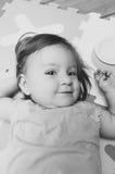 Beautiful baby girl lying down Stock Photography