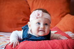 Beautiful baby girl lying on her stomach Stock Photography