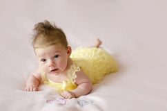 Beautiful baby girl lying on tummy Stock Photos