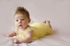 Beautiful baby girl lying on tummy Royalty Free Stock Image