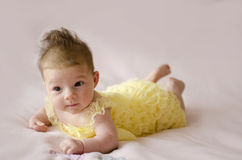 Beautiful baby girl lying on tummy Stock Image
