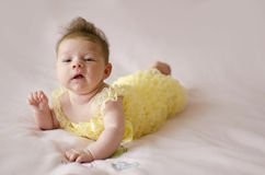 Beautiful baby girl lying on tummy Stock Photography