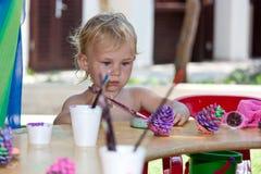 Beautiful baby girl painting Royalty Free Stock Photos