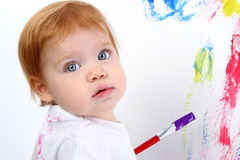 Beautiful Baby Girl Painting On Poster Board Royalty Free Stock Photography
