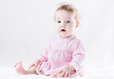 Beautiful baby girl in a pink dress on a white background Royalty Free Stock Photography