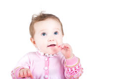 Beautiful baby girl in a pink knitted jacket Stock Photos