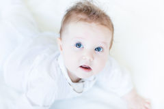 Beautiful baby girl playing on her tummy Stock Photo