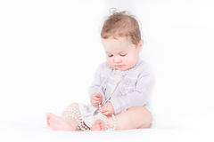 Beautiful baby girl playing with pearls Stock Images