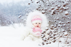 Beautiful baby girl playing in the snow Royalty Free Stock Photos