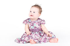Beautiful baby girl in a purple dress Royalty Free Stock Photos
