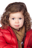 Beautiful baby girl with red coat Stock Photography