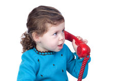 Beautiful baby girl with a red telephone Royalty Free Stock Images