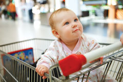 Beautiful baby girl in shopping cart - trolley Stock Images