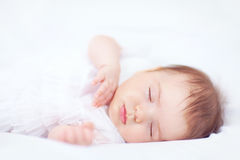 Beautiful baby girl sleeping in bed, two months old Royalty Free Stock Images