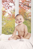 Beautiful baby girl smiling on bedroom Stock Photo