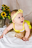 Beautiful baby girl smiling and looking up Royalty Free Stock Photography