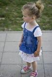 Beautiful Baby Girl is Standing on the Walkway. In Beutiful Skirt Stock Photos