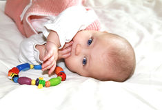 Beautiful baby girl sucking fingers royalty free stock images