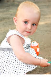Beautiful baby girl in summer Stock Photo