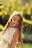 Beautiful baby girl summer evening having fun in the sunlight stock photos