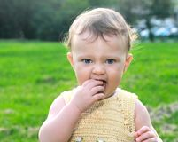 Beautiful baby girl tasting Stock Images