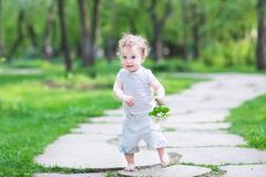 Beautiful baby girl walking in the park Royalty Free Stock Image