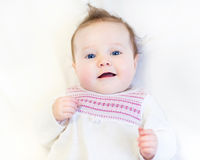 Beautiful baby girl in a warm knitted pink dress Stock Image