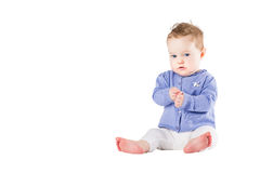 Beautiful baby girl wearing a purple sweater clapping her hands Royalty Free Stock Photo