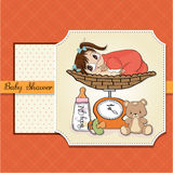 Beautiful baby girl on on weighing scale Royalty Free Stock Photo