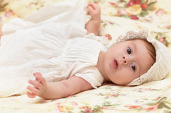 Beautiful baby girl in white dress Stock Image