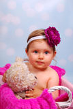 Beautiful baby girl in wicker basket ,10 months Royalty Free Stock Image