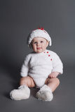 Beautiful baby in a knit dress and cap Royalty Free Stock Photos