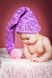 Beautiful baby in knitted cap Stock Photography