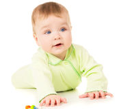 Beautiful baby learns to crawl Stock Photo