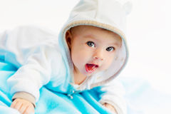 Beautiful baby lying on a blue plaid Stock Photo