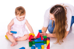 Beautiful baby with mother building with cubes Royalty Free Stock Photo