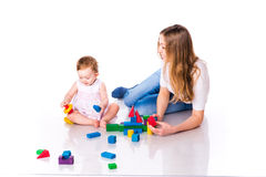 Beautiful baby with mother building with cubes Stock Photos