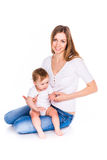 Beautiful baby and mother playing Stock Photo