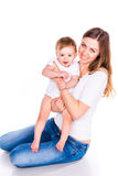 Beautiful baby and mother playing Royalty Free Stock Photo