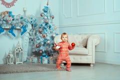 Beautiful baby near Christmas tree Royalty Free Stock Photography