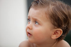 Beautiful baby outside with wet hair Royalty Free Stock Photography