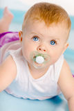 Beautiful baby with a pacifier. Close-up. Studio photo Royalty Free Stock Photos